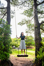 Young Lady Standing On Swing L...