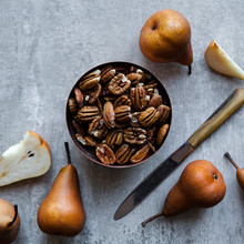 Bowl Of Pecan Nuts And Pears