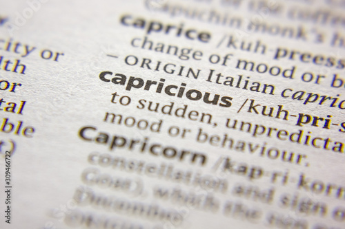 Photo Word or phrase Capricious in a dictionary.