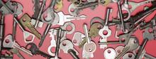 Keys Set On Pink Background. Door Lock Keys And Safes For Proper