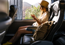 Woman Using Phone In Bus