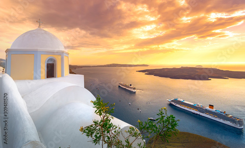 Leinwand Poster Amazing evening view of Fira, caldera, volcano of Santorini, Greece with cruise ships at sunset