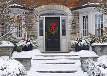Front Door Of Snow Covered Hou...