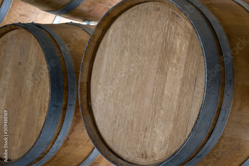 Carta da parati Wooden barrels stand on top of each other, wine storage, part of the interior, the structure of the tree