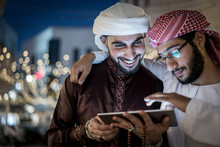 Two Arab Men With Tablet In Ci...