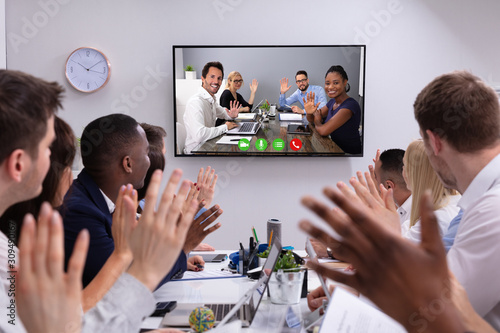 Fotografía  Businesspeople Having Video Conference In Boardroom