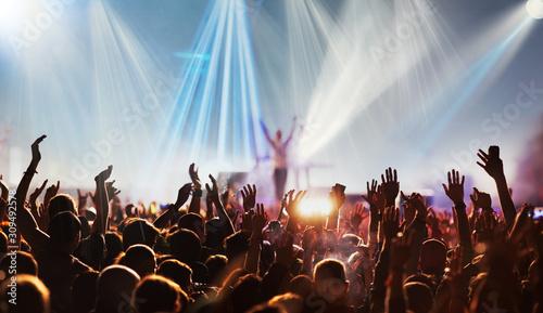 Fototapeta crowd with raised hands at concert festival banner obraz