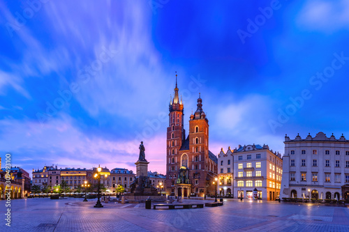 Medieval Main market square with Basilica of Saint Mary and Cloth Hall in Old Town of Krakow at sunrise, Poland