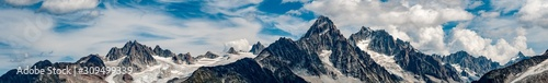 Fototapeta Panorama the Aiguille du Chardonnay and surrounds above Argentiere and Chamonix with cloudy blue sky obraz