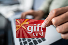 Man Holding Red Gift Card