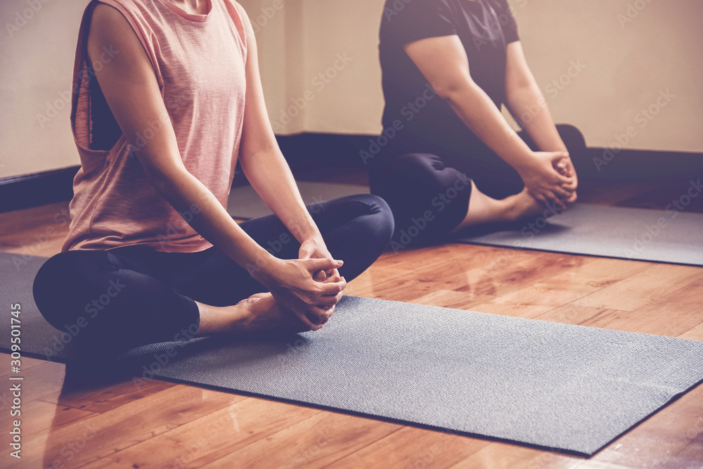 Fototapeta healthy Asian women practicing yoga, beginner, wellness and fitness lifestyle concept, new year 2020 health resolution, home online workout exercise, social distance, isolation - obraz na płótnie