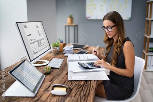 Photo Accountant Calculating Tax At Desk