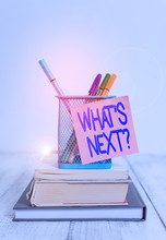 Word Writing Text What S Next Question. Business Photo Showcasing Asking Demonstrating About His Coming Actions Or Behaviors Stacked Books Pens Metal Holder Sticky Note Lying Vintage Old Wooden Table