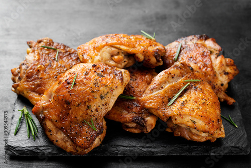 Fototapeta Grilled chicken thighs with spices and lemon.  obraz