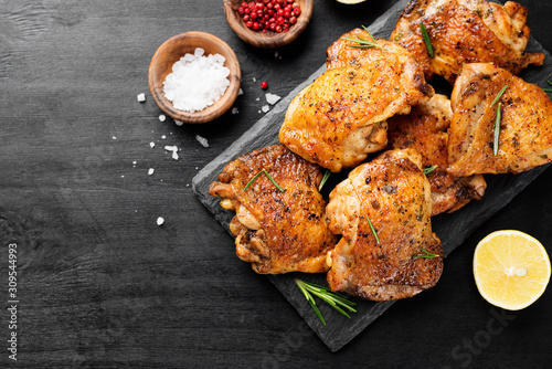 Grilled chicken thighs with spices and lemon. Top view Fototapeta