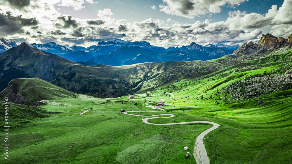 Fototapeta Winding road in Passo Giau and green Dolomites, aerial view