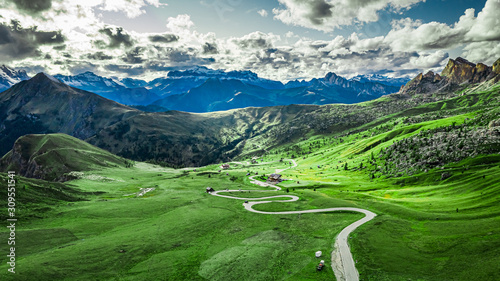 Winding road in Passo Giau and green Dolomites, aerial view - 309551541