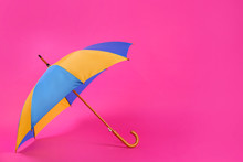 Colorful Umbrella On Pink Background. Space For Text