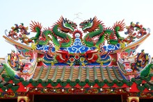 Dragon Statue On Chinese Temple Roof With Sky Background