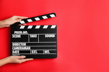 Woman Holding Clapperboard On ...