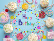 canvas print picture - Flat lay composition with cupcakes on light blue background. Happy Birthday