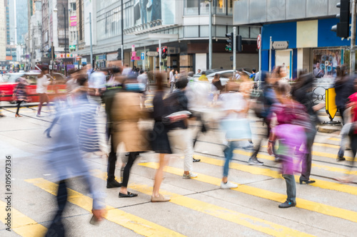 Canvastavla pedestrian crossing in busy city, people walking,  blur