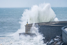 Powerful Waves Breaking At Breakwater During A Storm