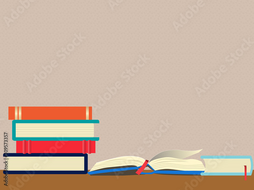 Stampa su Tela Front view of a stack of books next to an open book on the desk against a patterned wall