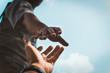 Leinwanddruck Bild - Help Concept hands reaching out to help each other in dark tone.