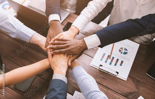 Fotografie, Obraz Top view on diverse corporate team hands stacked together