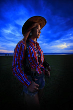 Young Cowgirl With Handgun On Twilight Time