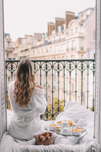 Young Woman With Blonde Hair On Balcony In Paris France