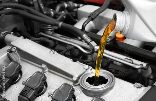 Obraz na plátně Synthetic motor oil pouring, fresh motor oil