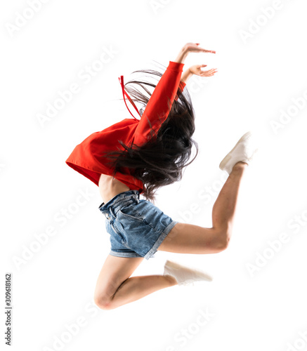 Photo Young asian dancer over isolated white background