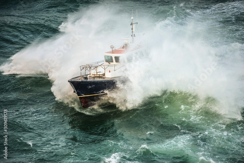incredible view of a pilot boat in the storm Canvas Print