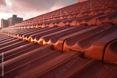 Fototapeta Wet red roof tiles after rain obraz