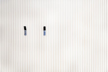 White Wall Of Wooden Slats With Two Hangers, Planks Pattern Background, Texture Of Wood Lath Wall