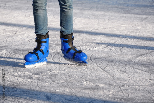 Bright Blue plastic skates in the background of scratched ice in a Sunny day Tablou Canvas