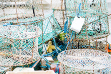 Crab And Lobster Pots On A Pontoon Covered With Morning Frost