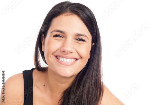 Leinwand Poster portrait of a happy young brunette woman laughing