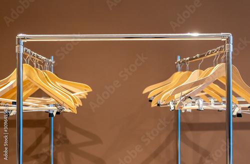 Fototapeta  Empty hangers on coat rack with no clothes in cloakroom
