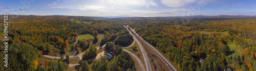 Fototapeta Interstate Highway 93 at Exit 22 with NH Route 127 in White Mountain National Forest panorama aerial view with fall foliage, Town of Sanbornton, New Hampshire NH, USA