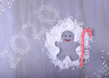 Gingerbread Man Silhouette With Candy Cane In Artificial Snow On Gray Table. Creative New Year Card