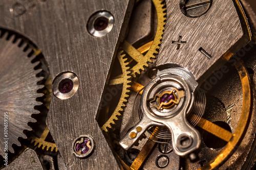 Fototapeta vintage old mechanism with gears and springs, clock mechanism close-up macro obraz