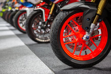 Motorcycles Parked On The Motorcycles Parking Lot, Closeup Of Motorcycles Front Wheel.