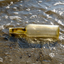 Washed Up Bottle On The Beach At Dead Horse Bay/Glass Bottle Beach, Barren Island, Jamaica Bay Unit Of The Gateway National Recreation Area, Brooklyn, New York, USA.