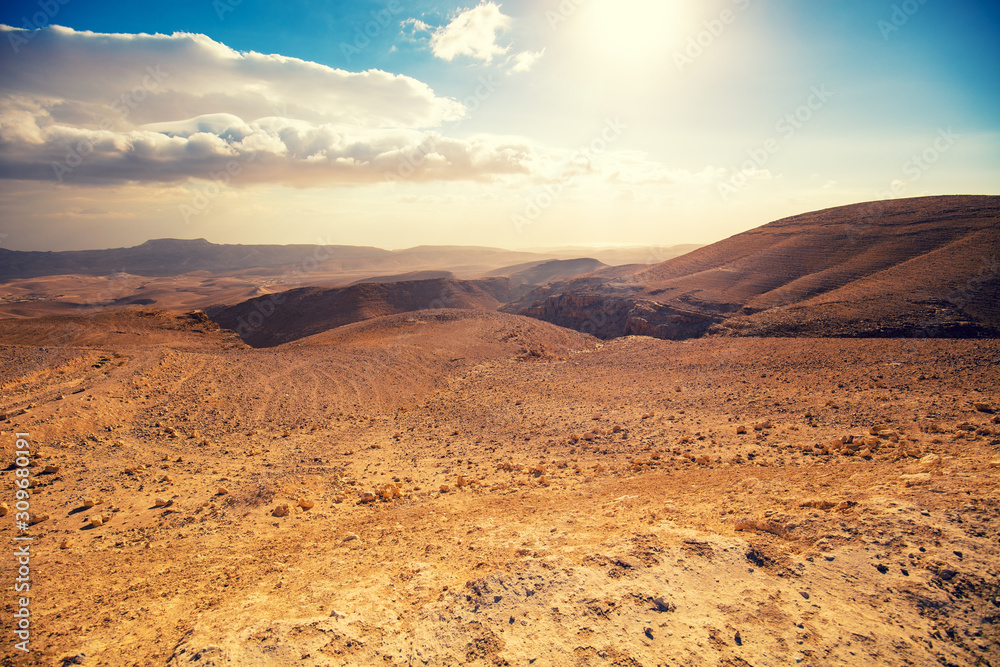 Fototapeta Mountainous desert with a beautiful cloudy sky. Desert in Israel at sunset