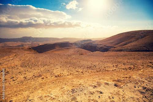 Mountainous desert with a beautiful cloudy sky Canvas Print