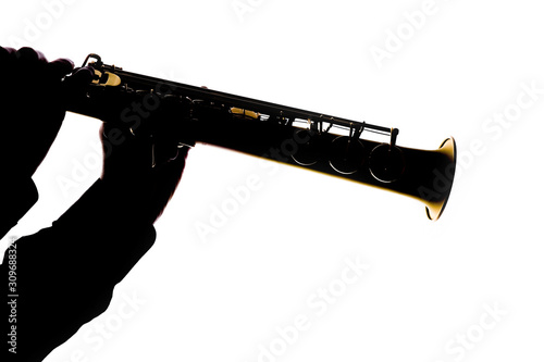 saxafon on a white background in the hands of a musician silhouette Canvas Print