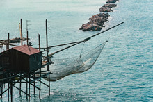 Trabucco, Also Known As Trabocco Are Small Wooden Cabins Built Over The Sea On Stilts. They Are Typically Found In The Regions In Central And South Italy Along The Coast Of The Adriatic Sea.